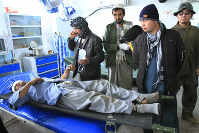 An Afghan man wounded in a roadside blast is treated at a local hospital in the city of Ghazni, west of Kabul, Afghanistan, on Dec. 13, 2019. (AP Photo/Rahmatullah Nikzad)