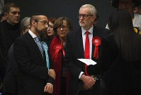 British opposition Labour Party leader Jeremy Corbyn, right, waits for the declaration of his seat in the 2019 general election in Islington, London, Friday, Dec. 13, 2019. (AP Photo/Alberto Pezzali)