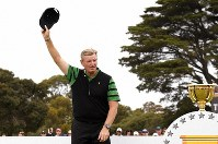 International team captain Ernie Els raises his hat during the presentation ceremony after the U.S. team won the President's Cup golf tournament at Royal Melbourne Golf Club in Melbourne, Sunday, Dec. 15, 2019. The U.S. team won the tournament 16-14. (AP Photo/Andy Brownbill)
