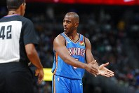 Oklahoma City Thunder guard Chris Paul, right, argues for a call with referee Eric Lewis in the second half of an NBA basketball game against the Denver Nuggets Saturday, Dec. 14, 2019, in Denver. (AP Photo/David Zalubowski)