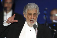 In this Aug. 28, 2019, file photo, opera singer Placido Domingo performs during a concert in Szeged, Hungary. (AP Photo/Laszlo Balogh)