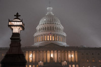 The U.S. Capitol in Washington is shrouded in mist, on Dec. 13, 2019. (AP Photo/J. Scott Applewhite)