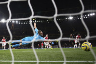 Arsenal's goalkeeper Bernd Leno, left, fails to save the ball as Manchester City's Raheem Sterling, third right, scores his side's second goal during the English Premier League soccer match between Arsenal and Manchester City, at the Emirates Stadium in London, on Dec. 15, 2019. (AP Photo/Ian Walton)