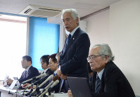 Satoshi Abe (standing), head of the plaintiffs' legal team, speaks at a news conference following the Yamagata District Court ruling in the city of Yamagata, northern Japan, on Dec. 17. 2019. (Mainichi/Akane Matono)