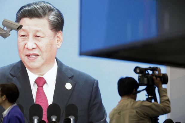 対米貿易にも余裕を見せる習近平国家主席(11月5日の上海国際輸入博覧会)(Bloomberg)