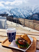 A croissant sandwich made with local Hakuba pork and served with hot chocolate, is seen at