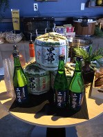 Barrels and bottles of locally brewed Japanese sake are seen at the Main Lounge for the