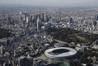 Tokyo's Shinjuku Ward, including the newly completed National Stadium (foreground) that will serve as the main venue for the 2020 Olympic and Paralympic Games, is seen in this image taken from a Mainichi Shimbun helicopter on Nov. 30, 2019. (Mainichi)