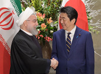 Japan's Prime Minister Shinzo Abe and Iran's President Hassan Rouhani are seen shaking hands ahead of a bilateral leaders' meeting at the prime minister's office in Tokyo on Dec. 20, 2019. (Mainichi/Masahiro Kawata)