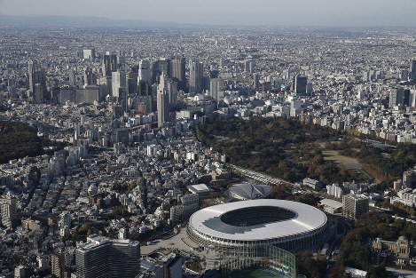 The National Stadium, below, the main venue for the 2020 Tokyo Olympics and Paralympics, is seen in this photo taken from a Mainichi Shimbun helicopter on Nov. 30, 2019. (Mainichi)