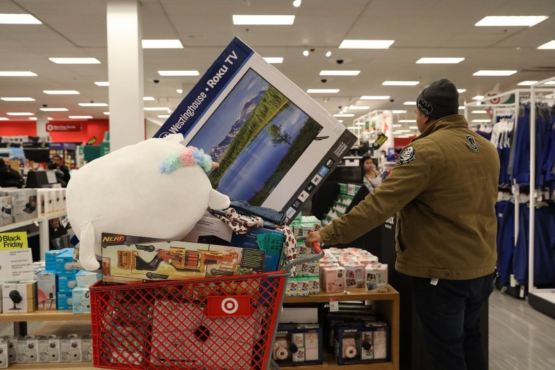 A customer pushes shopping cart at a Target Corp. store in the Queens borough of New York, U.S, on Thursday, Nov. 28, 2019. A gauge of buying conditions in the U.S. advanced last week to 55.3, the highest ever leading up to the first shopping day after the Thanksgiving holiday, according to Bloomberg Consumer Comfort Index data. Photographer: Bess Adler/Bloomberg