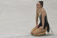 In this March 23, 2018, file photo, Kaetlyn Osmond, of Canada, reacts after completing her women's free skating program at the Figure Skating World Championships in Assago, near Milan, Italy. (AP Photo/Luca Bruno)