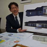 拠点施設のイメージパネルを手に構想を語る重岡昌吾社長=橋本市神野々の「ゆの里」で、松野和生撮影