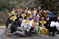 Men wearing suits and kimonos hold matching fans and pose for a commemorative photo during a coming-of-age ceremony in the city of Saiki, Oita Prefecture, on Jan. 12, 2020. (Mainichi/Hyelim Ha)