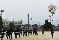 Men wearing suits fly an enormous kite they made to celebrate their coming-of-age at the playground of Seitoku Junior High School in the city of Higashiomi, Shiga Prefecture, on Jan. 12, 2020. (Mainichi/Shinya Hasumi)