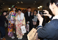 Women clad in kimonos and others pose for a commemorative photo during a coming-of-age ceremony in the city of Shunan, Yamaguchi Prefecture, on Jan. 12, 2020. (Mainichi/Masaki Matsumoto)