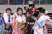 Women clad in kimonos pose for a commemorative photo with KitaQman, a hero mascot of the city of Kitakyushu, during a coming-of-age ceremony in the city's Kokurakita Ward on Jan. 12, 2020. (Mainichi/Takashi Kamiiriki)