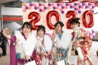 Women clad in kimonos take a selfie during a coming-of-age ceremony at Kurashiki Sports Park in the city of Kurashiki, Okayama Prefecture, on Jan. 12, 2020. (Mainichi/Hanami Matsumuro)