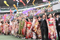 People clad in kimonos and suits release colorful balloons in the air during a coming-of-age ceremony at Kurashiki Sports Park in the city of Kurashiki, Okayama Prefecture, on Jan. 12, 2020. (Mainichi/Hanami Matsumuro)