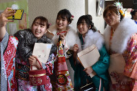 Women clad in kimonos take a selfie during a coming-of-age ceremony in the town of Kawamata, Fukushima Prefecture, on Jan. 12, 2020. (Mainichi/Hideyuki Kakinuma)