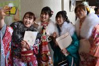 Women clad in kimonos take a selfie during a coming-of-age ceremony in the town of Kawamata, Fukushima Prefecture, on Jan. 12, 2020. (Mainichi/Hideyuki Kakinuma)
