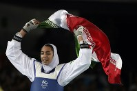In this Aug. 18, 2016 file photo, Kimia Alizadeh Zenoorin of Iran celebrates after winning the bronze medal in a women's Taekwondo 57-kg competition at the 2016 Summer Olympics in Rio de Janeiro, Brazil. (AP Photo/Andrew Medichini)