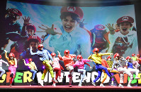 Dancers perform at the presentation to reveal Universal Studios Japan's