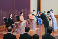 Emperor Naruhito and Empress Masako, as well as other Imperial Family members, are seen at a New Year poetry reading ceremony at the Imperial Palace on Jan. 16, 2020. (Pool photo)