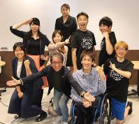 Leader Kunio Otani, front row center, and other