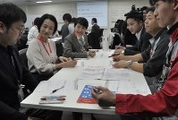 Japan Airlines Co. employees introduce themselves at a seminar on the