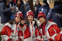 In this photo provided by the IOC, Japanese athletes pose for a selfie at the Vortex in the Youth Olympic Village, on Jan. 9, 2020, at the 2020 Winter Youth Olympic Games in Lausanne, Switzerland. (Joel Marklund/OIS, IOC via AP)