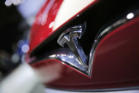 This Sept. 30, 2016 file photo shows the logo of the Tesla model S at the Paris Auto Show in Paris, France. (AP Photo/Christophe Ena)