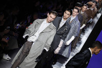 Models wear creations for the Dior Homme Mens Fall/Winter 2020-2021 fashion collection presented in Paris, on Jan. 17, 2020. (AP Photo/Francois Mori)
