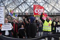 Striking employees demonstrate outside the Louvre museum on Jan. 17, 2020, in Paris. (AP Photo/Francois Mori)