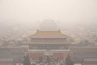 Tourists exit the Forbidden City in Beijing, on Jan. 18, 2020. (AP Photo/Mark Schiefelbein)