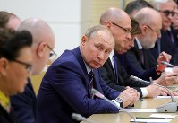 In this Jan. 16, 2020 photo, Russian President Vladimir Putin attends a meeting on drafting constitutional changes at the Novo-Ogaryovo residence outside Moscow, Russia. (Mikhail Klimentyev, Sputnik, Kremlin Pool Photo via AP)