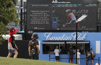 A sign warns spectators of air quality ahead of the Australian Open tennis championship in Melbourne, Australia, on Jan. 18, 2020. (AP Photo/Lee Jin-man)