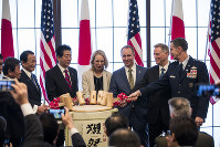From left; Japan's Foreign Minister Toshimitsu Motegi, deputy prime minister Taro Aso, Prime Minister Shinzo Abe, granddaughter Mary Jean Eisenhower and the great grandson Merrill Eisenhower Atwater of former U.S. President Dwight Eisenhower, acting U.S. Ambassador to Japan Joseph M. Young and Commander of the U.S. Forces in Japan Lieutenant General Kevin Schneider break a barrel of sake to celebrate the 60th anniversary commemorative reception of the signing of the Japan-US security treaty at the Iikura Guesthouse in Tokyo, on Jan. 19, 2020.  (Behrouz Mehri/Pool Photo via AP)