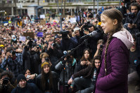 17-year-old Swedish climate activist Greta Thunberg, front, delivers a speech after an environmental