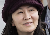 In this March 6, 2019, file photo, Huawei chief financial officer Meng Wanzhou arrives back at her home after a court appearance in Vancouver, British Columbia. (Darryl Dyck/The Canadian Press via AP)