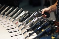 In this Jan. 19, 2016, file photo, handguns are displayed at the Smith & Wesson booth at the Shooting, Hunting and Outdoor Trade Show in Las Vegas. (AP Photo/John Locher)