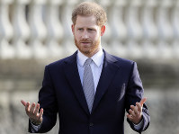 Britain's Prince Harry gestures in the gardens of Buckingham Palace in London, on Jan. 16, 2020. (AP Photo/Kirsty Wigglesworth)