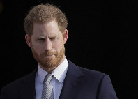 In this Jan. 16, 2020, file photo, Britain's Prince Harry arrives in the gardens of Buckingham Palace in London. (AP Photo/Kirsty Wigglesworth)