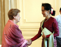 Myanmar's leader Aung San Suu Kyi, right, shakes hands with Philippine diplomat Rosario Manalo, a member of the Independent Commission of Enquiry for Rakhine State, at the Presidential Palace in Naypyitaw, Myanmar, on Jan. 20, 2020. (AP Photo/Aung Shine Oo)