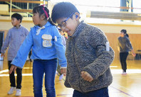 Students wearing Ontenna devices on their arms dance to match vibrations converted from sounds, at Fukushima Prefectural School for the Deaf in the city of Koriyama, in northeastern Japan, on Jan. 21, 2020. (Mainichi/Naoki Watanabe)