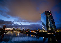 Clouds drift over the European Central Bank, right, in Frankfurt, Germany, on Jan. 18, 2020. (AP Photo/Michael Probst)