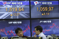 Currency traders work at the foreign exchange dealing room of the KEB Hana Bank headquarters in Seoul, South Korea, on Jan. 22, 2020. (AP Photo/Ahn Young-joon)