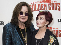 This June 11, 2018 file photo shows musician Ozzy Osbourne, left, and his wife Sharon Osbourne at the Metal Hammer Golden God awards in London. (Photo by Vianney Le Caer/Invision/AP)