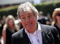 In this Aug. 21, 2010 file photo, Terry Jones arrives at the Creative Arts Emmy Awards in Los Angeles. (AP Photo/Chris Pizzello)