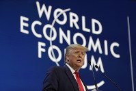 President Donald Trump delivers the opening remarks at the World Economic Forum, on Jan. 21, 2020, in Davos. (AP Photo/ Evan Vucci)